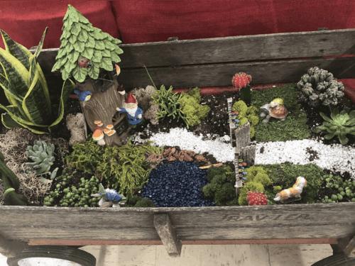 Fairy garden in a wagon.