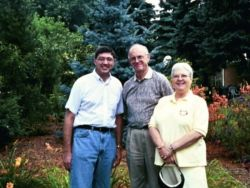 In 2000 Marvin and Emilie Snyder visited with Dennis Groh (left) in his Michigan garden