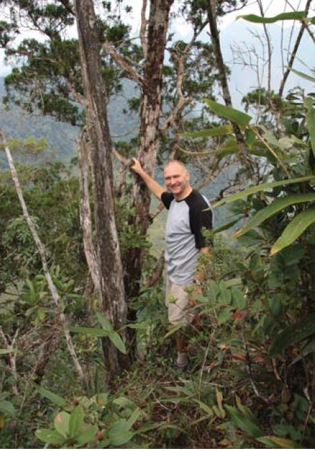 Chris Reynolds with mature Vietnamese golden cypress (Cupressus vietnamensis)