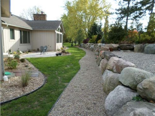 Berm after rock wall installation in the conifer garden