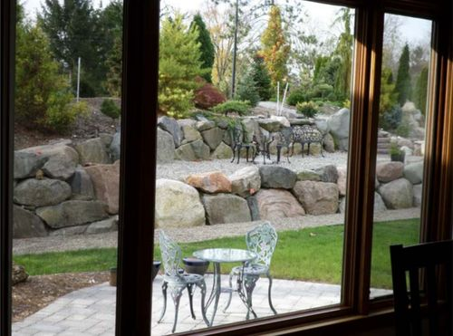 The view of the conifer garden from inside the house