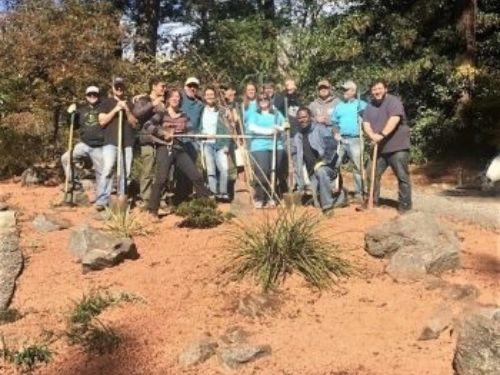 Citrix volunteers in the new rock garden.